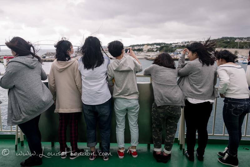 Japanese girls taking selfie photos ferry motobu to ie island okinawa japan