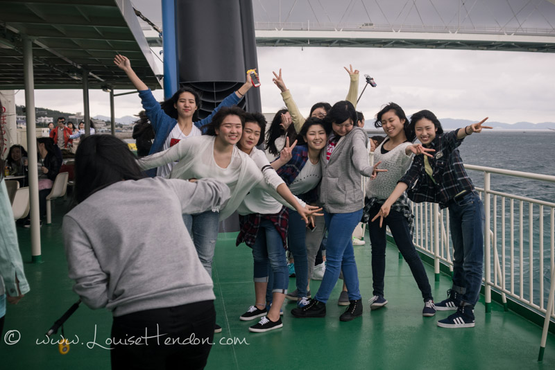 Japanese girls taking selfies ferry motobu to ie island okinawa japan