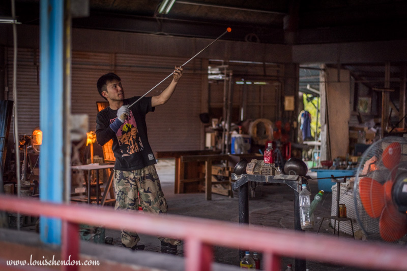 yomitan pottery village man blowing glass okinawa japan photos