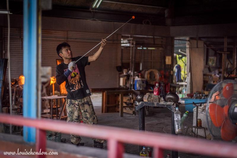 yomitan pottery village man blowing glass okinawa japan photos