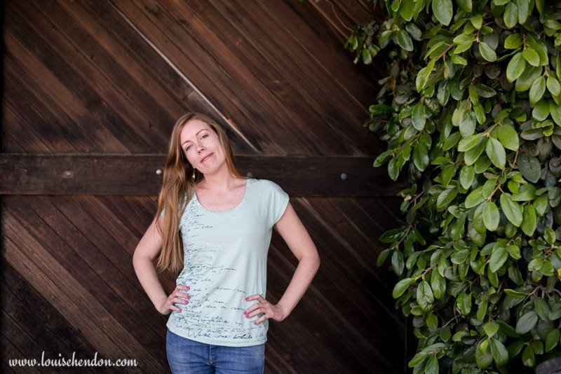 Kate Hill Portrait photography at Smith Madrone Winery in Napa California - wooden barn door background