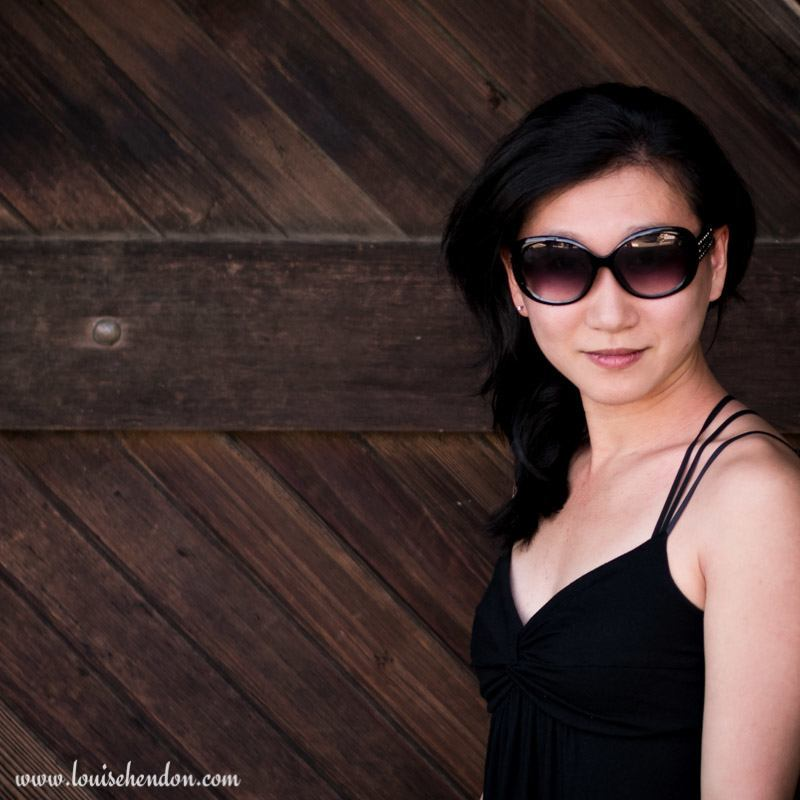 Louise Hendon Portrait photography at Smith Madrone Winery in Napa California - wooden barn door background