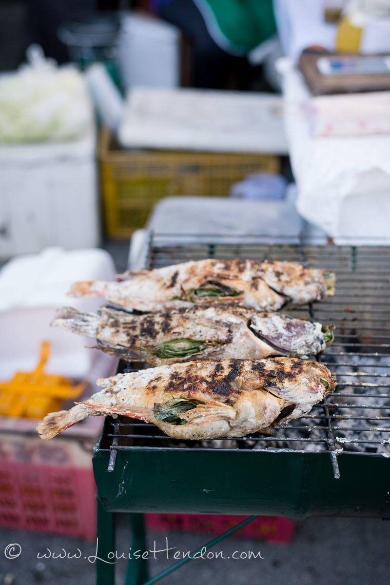Grilled fish at bo sang umbrella festival in Thailand - photography