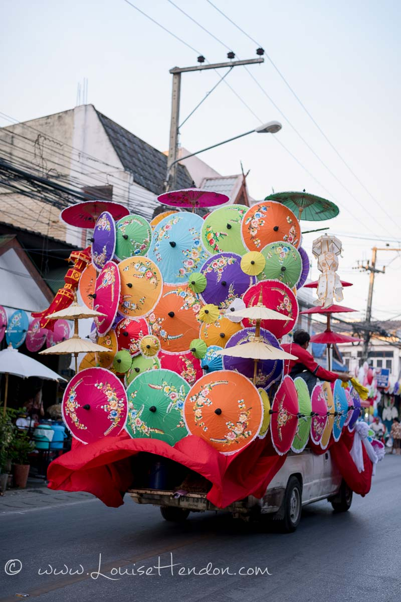 Photos of the floats at the parade at The Umbrella Festival in Ba Song, Thailand